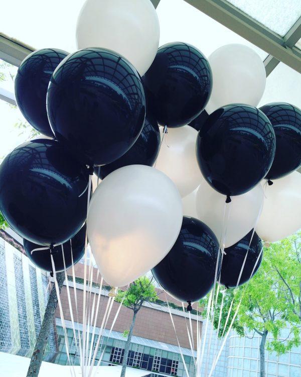 Black and white helium balloons