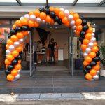 Orange Black and Silver Balloon Arch